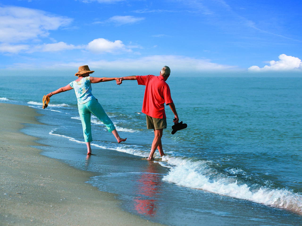 Carefree Couples Innsider Walk on the Beach